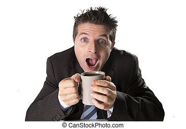 addict businessman in suit and tie holding cup of coffee as...