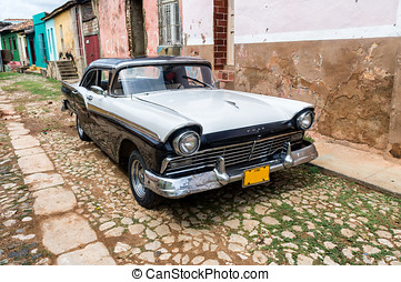 Street scene with vintage car in HTrinidad, Cuba.