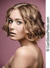 girl with blonde curly hair-cut