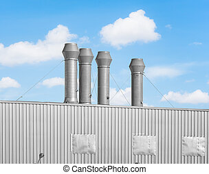 Ventilation system of factory with blue sky background.