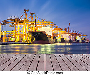 cargo ship - Cargo ship and crane at port with wood bridge,...