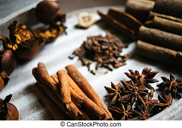 Spices like anice and cinnamon in the spoon and the...