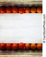 cherry tomatoes on wood - grunge frame
