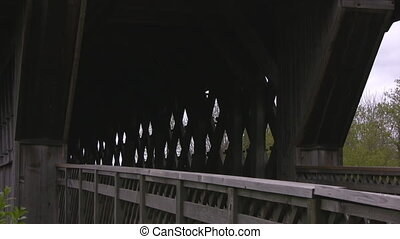 Covered walking bridge zoom out - Closeup of an empty wooden...