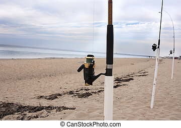 Fishing poles on Cape Cod - Fishing poles on the beach at...