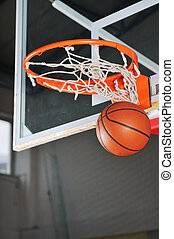 basket ball in basketball basket ; - oreange basket ball in...