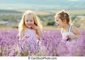 happy friends - two happy girls in field