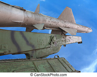 Old russian antiaircraft defense rocket launcher over blue sky