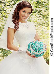 bride with a bouquet of turquoise stone, vintage