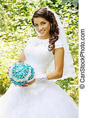 bride with a bouquet of turquoise stone