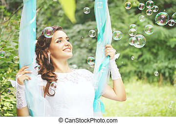 bride with soap bubbles, tinted - The beautiful bride on a...