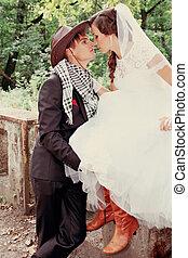 Bride kissing groom, tinted