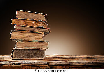 Old books on wooden table - Old books on wooden planks with...