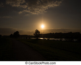 silhouette sunset over water - Silhouette sunset over river...
