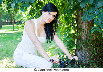 woman on a bicycle in the park