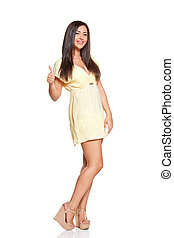 young sun-tanned woman dressed in a lite summer yellow dress...