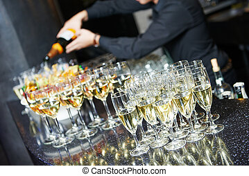 Waiter bartender pouring wine at party - Waiter bartender...