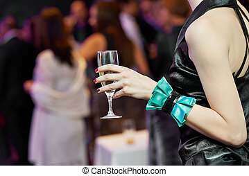 Guest hand and glass with wine at party - Female woman guest...