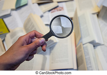 magnifying glass - magnifyng glass and books