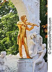 The statue of Johann Strauss with violin - Waltz King plays....