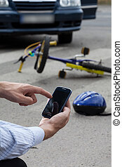 Calling emergency service after accident on the street