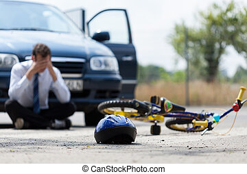 Driver after car accident - Driver sitting on the street...