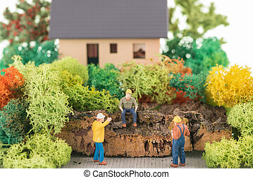Miniature workers renovate house - Miniature workers getting...