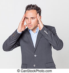 headache - Businessman having headache