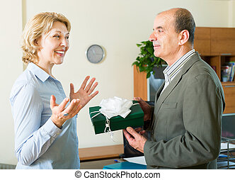 businesswoman receiving a gift - Happy businesswoman...