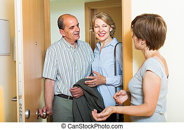 Daughter greeting parents at threshold - Positive adult...