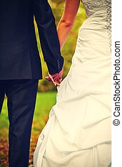 Wedding day - couple holding hands - retro colors