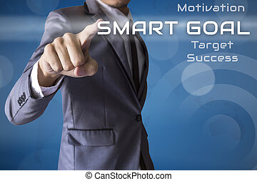 Businessman touch Goal of business conceptual