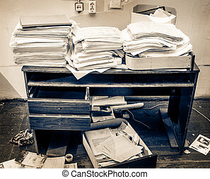 Messy workplace with stack of paper