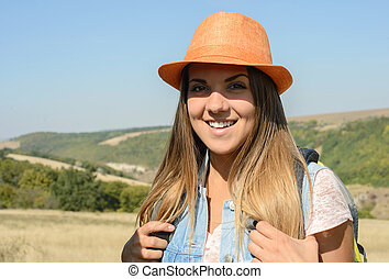 Camping - Beautiful girl hiking outdoors leading a healthy...
