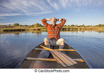 enjoying evening canoe paddling