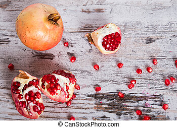pomegranate on rough wooden table