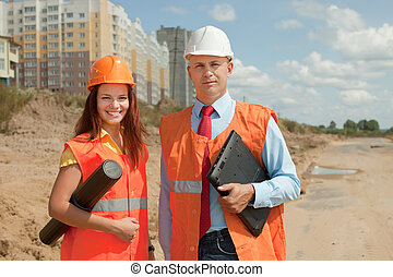 builders standing at building site