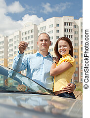 couple with key against new house - Happy couple with key...