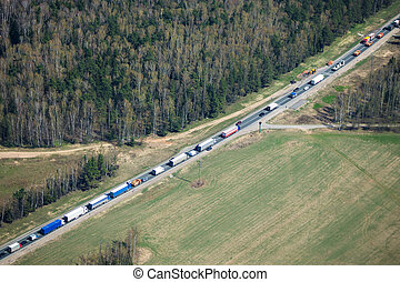 Heavy traffic - Aerial view of a traffic jam with trucks on...