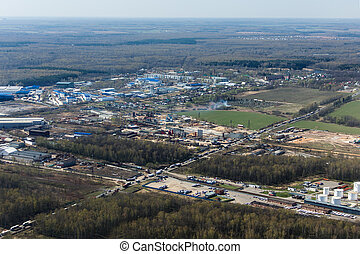 Industrial view - Aerial view of industrial zone amid forest