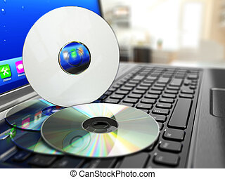 Software CD on laptop keyboard Compact disks 3d
