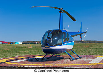 Helicopter - Front view of small blue landed helicopter