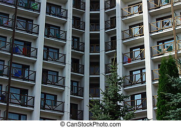 high-rise building - the front of the tall apartment...