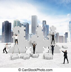 Build a new company - Business people builds together a new...