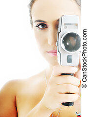 woman with camera - young beautiful woman face closeup with...