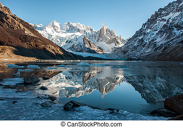 Frozen lake reflection at the Cerro Torre, Fitz Roy,...