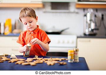 Boy baking cookies