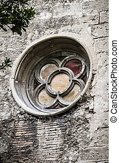 old gothic window, Spanish city of Valencia, Mediterranean...