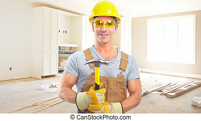 Handyman with a hammer. House renovation. - Handyman with a...