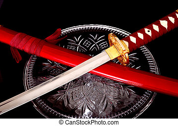 Samurai sword isolated over a black background